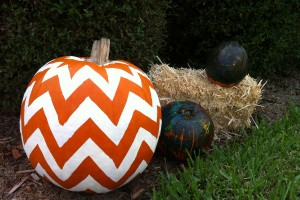 My pumpkin next to the pumpkins my son painted.