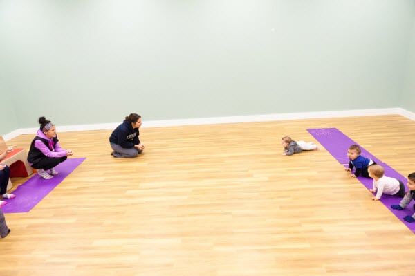 Community - Moms encouraging their babies during crawling races! (Photo Credit - Megan Johns Photography)