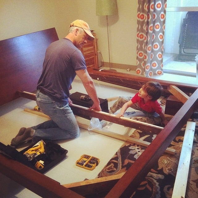 My husband, love of my life, patiently allowing our son to help him fix the bed. This is a romance scene from the Rodenhizer home.