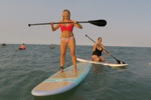 Some of us were more comfortable standing than others...that's me in the back going for the leisurely paddle.