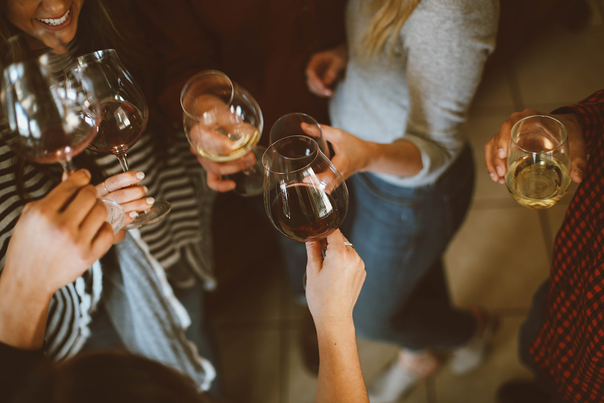 Group of women toasting with wine.