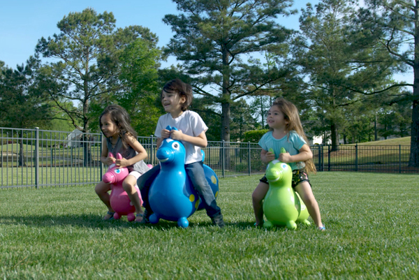Children riding on Rody Horses